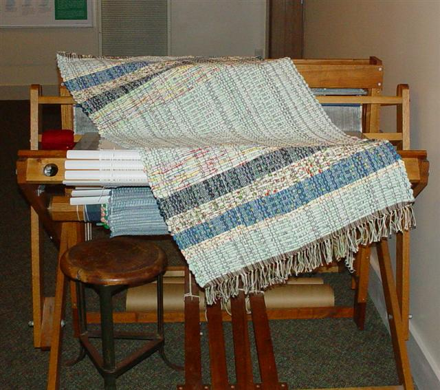 Rag rug laying across the PP Loom